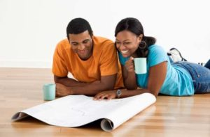 Photo of a couple looking over house plans - Building a house