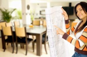 Photo of a sale rep and a floorplan - Building a house