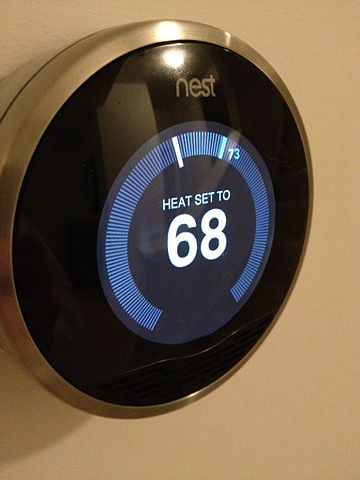 Photo of a Nest programmable thermostat