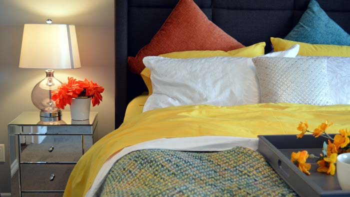 Photo of a bedroom with an attractive light fixture on the side table