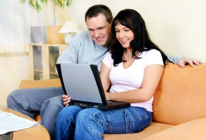 Photo of a couple home shopping on the Internet