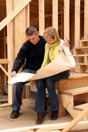 Photo of a couple at a new construction home site